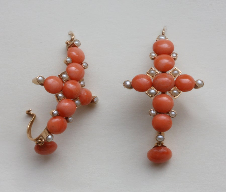 A pair of large 18 carat gold earrings with cabochon corals and small half natural pearls in the shape of crosses, France, 19th century.