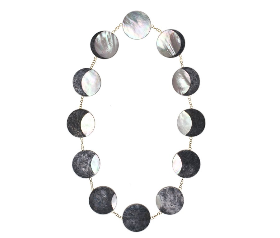 An important silver necklace representing the Eclipse made out of mother of pearl and niello. The eclipse is a major astrological sign for change, Philip Sajet, 2012.