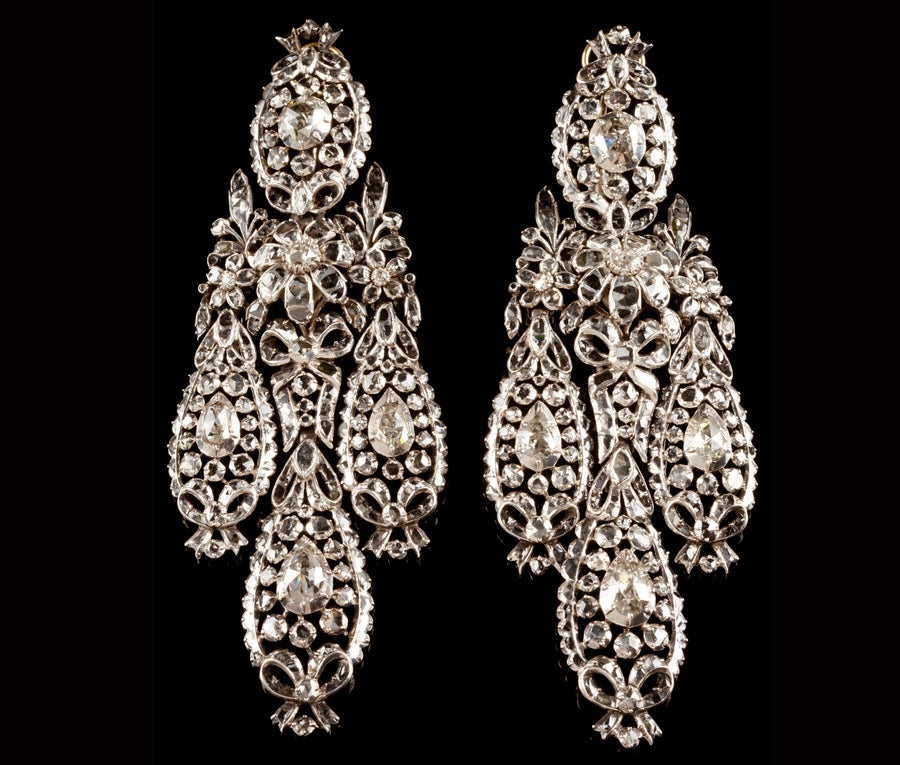 Fit for a Queen is more than a figure of speech when the subject is these large 18th century, Portuguese silver earrings, lavishly set with rose-cut diamonds. They compare favourably with the diamond earrings shown in this portrait of Princess