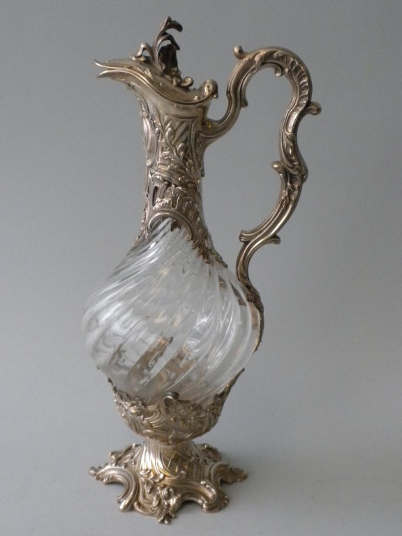 This elegant pair of French 1st Standard Silver (950/1000) Mounted Crystal Decanters was made by the Paris silversmithing firm of V. Boivin, Circa 1900.  The swirled crystal bodies are mounted with Louis XV style silver mounts with undulating scroll