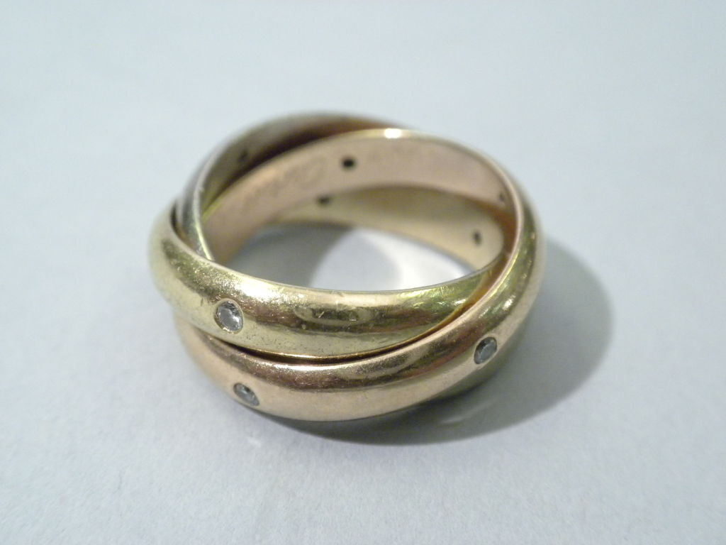 cartier tricolor gold and set rolling ring size 6