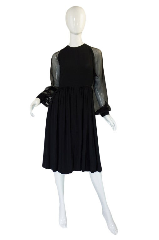 This wonderful little black dress is a testament to the greatness of James Galanos who was one of the great American Couturiers. Every detail on it is perfect and every seam is placed to ensure that the dress falls and sits properly once on and