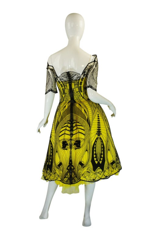 A once in a life time opportunity this is a very rare and wonderful McQueen dress! Only three of these were made for the North American market and it was the star of the Resort 2010 runway show. It was made even more infamous when Drew Barrymore