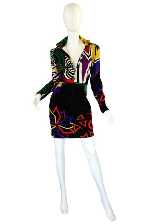 This is just classic, covetable Versace Versus dress! It is an insane and instantly recognizable controlled chaos of color done on a plush cotton velvet. The velvet allows the colors to be as crisp and bright as you would wish them to be and the cut