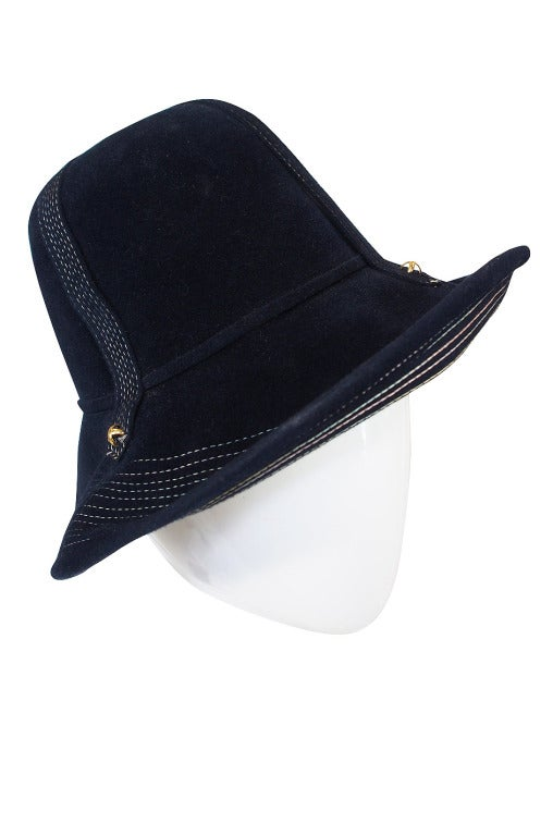 A fabulous, deep blue soft felt Yves Saint Laurent hat that feels fresh and relevant. The brim is top stitched with an array of pretty pastel color stitched stripes - pink, blue, yellow and white. These also have been done on the bands that cross