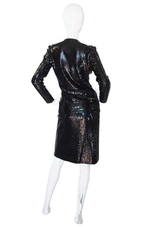 It was around 1973 that Halston embraced sequins and really started to showcase them in his collections. The sequin technique he used at this time differed from later pieces in that the sequins were laid flat in placed in rows that stacked on top of