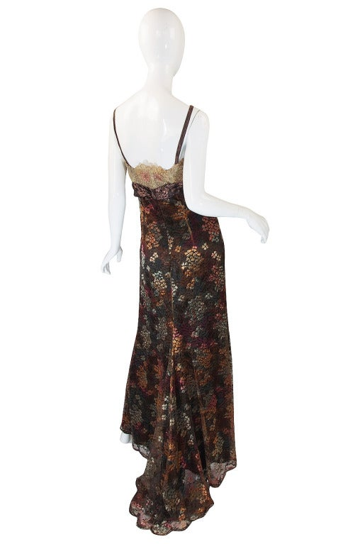 A stunning Christian LaCroix dress that shows his mastery in combining colors, fabric and textures. Every element on the gown has a depth and texture to it separate from the others and yet it all works perfectly together. The body of the gown is a