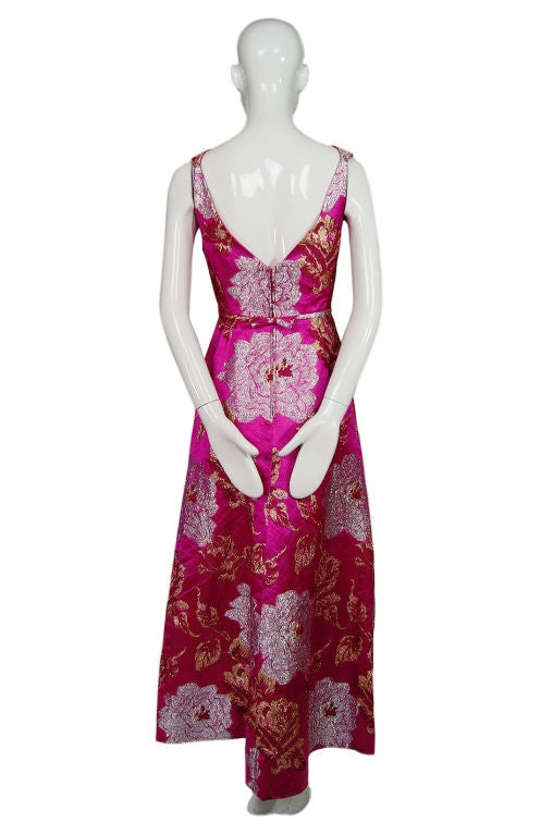 Seriously a stunning stunning dress - this silk brocade gown form Malcolm Starr is begging ot go to a gala dinner. The color is unbelievable - one of the best hue's of pink I have ever seen, the silk brocade add a level of richness that the photos