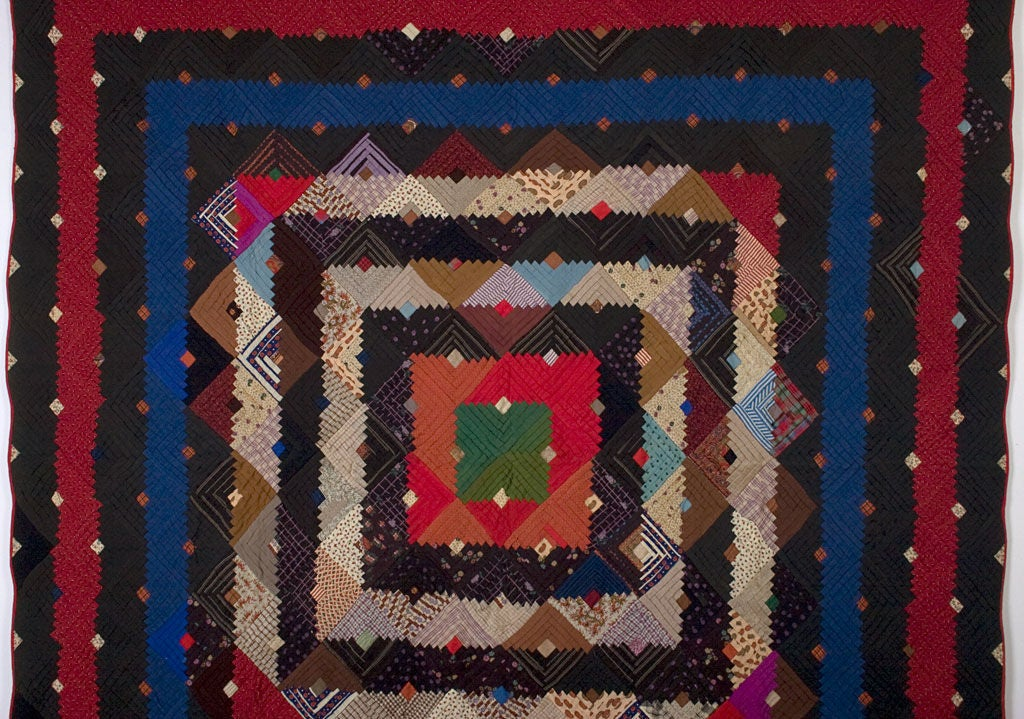 Richly colored Barnraising Log Cabin Quilt on Square done in beautiful wool challis fabrics. Solids and prints are well placed to make the various frames especially prominent. Excellent condition. Measures 78