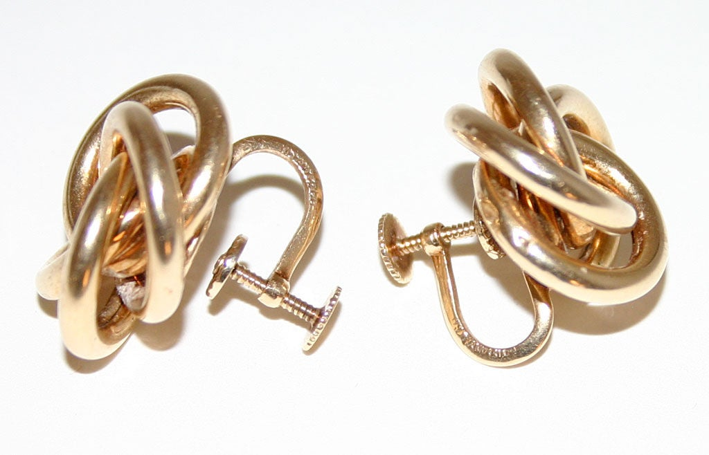 """These are an early version of Tiffany's Love Knot Earrings. They are 14 karat gold; measure 7/8"""" in diameter. Currently screw backs but can easily be modified to posts. Excellent condition."""