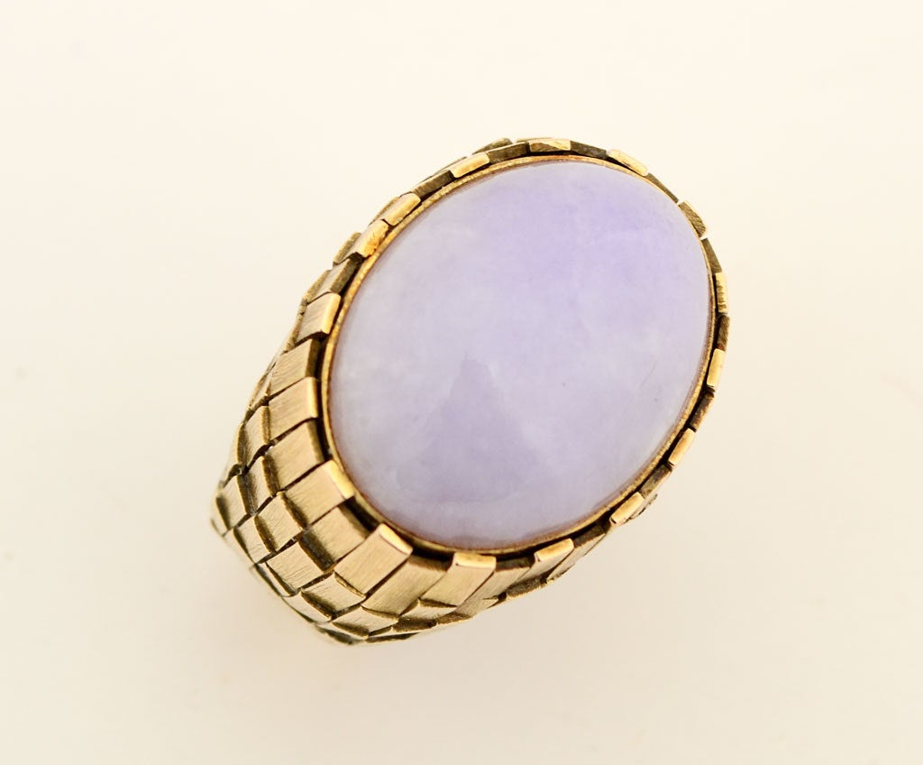 Wonderfully textured gold ring with a large cabochon lavender  jade. Overlapping gold rectangles create an unusual lattice effect. The stone measures 7/8