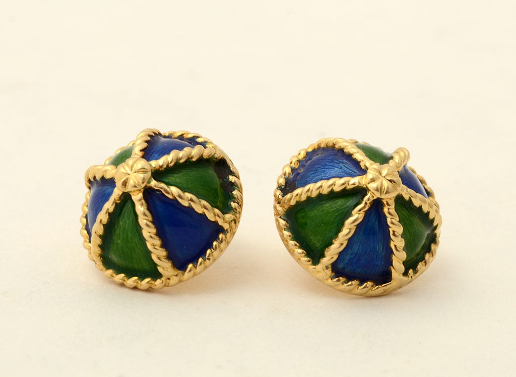 "Alternating blue and green enamel triangles are separated by twisted bands of 18 karat gold. These earrings by New Jersey maker, Krementz, measure 5/8"" in diameter."
