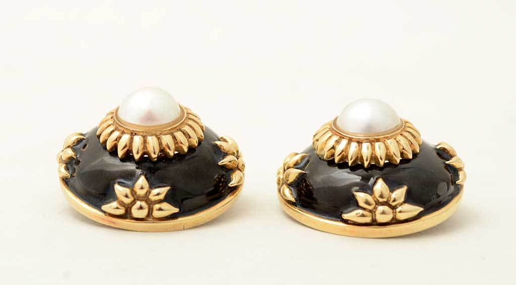Very large, stylized flower motif earrings made of gold, enamel and a central pearl. They are a set with item JU120528133322 but are being offered separately. The earrings measure 1 1/8