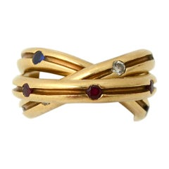 CARTIER  Rolling Ring with Diamonds, Rubies and Sapphires