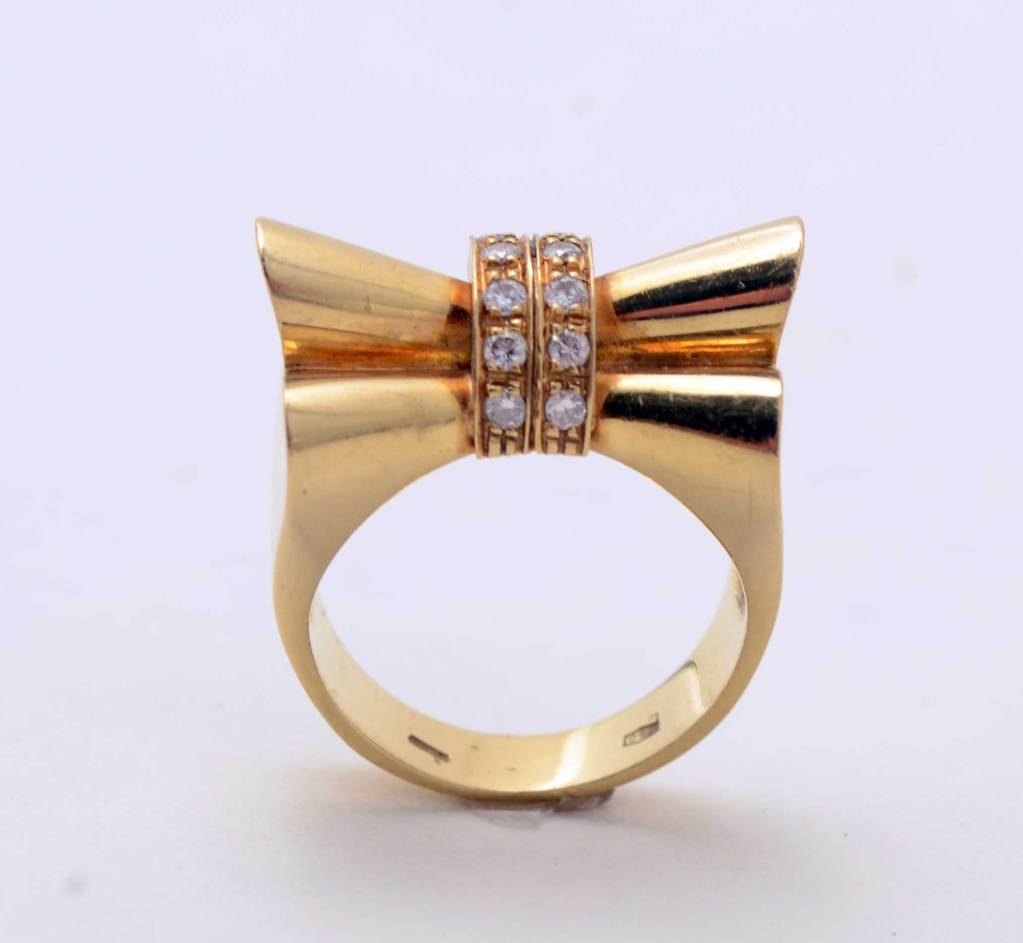 Eighteen karat gold and diamonds Bow Ring that is totally Retro in design. Very sculptural and interesting from all angles. It is size 7 but can easily be sized up or down.
