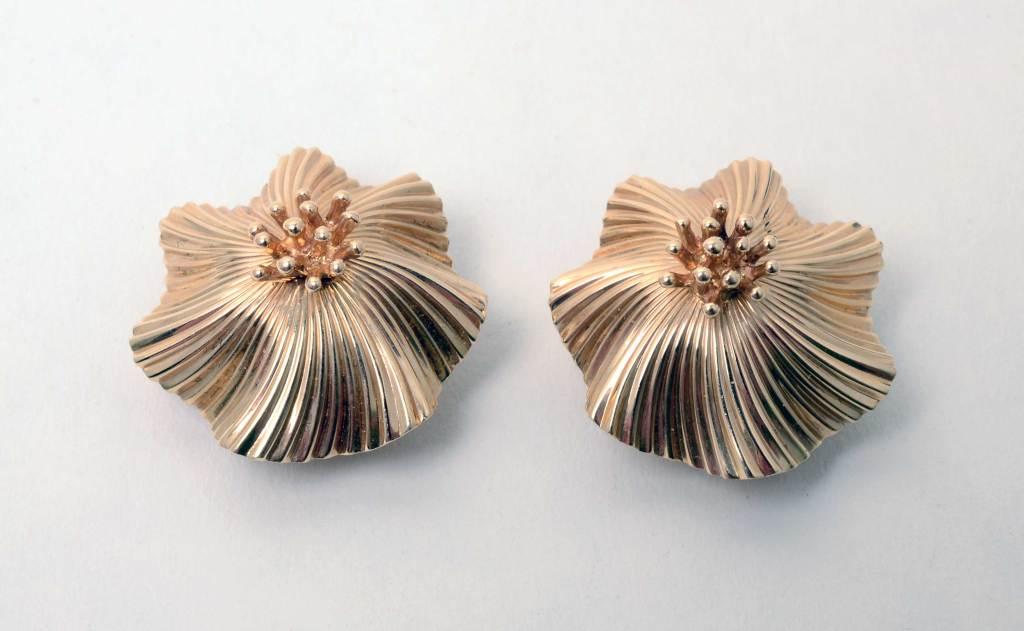 "Tiffany gold ear clips designed as flowers with a ribbed and undulating background as though they are blowing in a breeze. Measurements are 7/8"" in diameter."