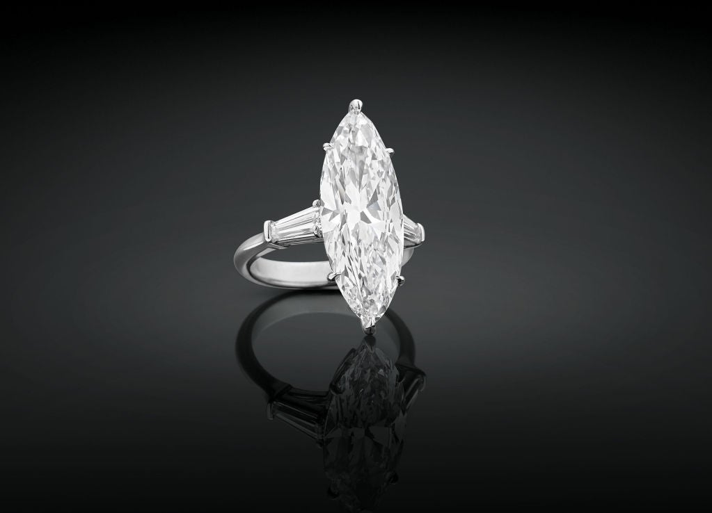 The extremely rare and highly important Internally Flawless diamond in this ring boasts all the hallmarks of the legendary Golconda diamonds. Weighing an amazing 8.03 carats, this glorious marquise-cut diamond is certified by the Gemological