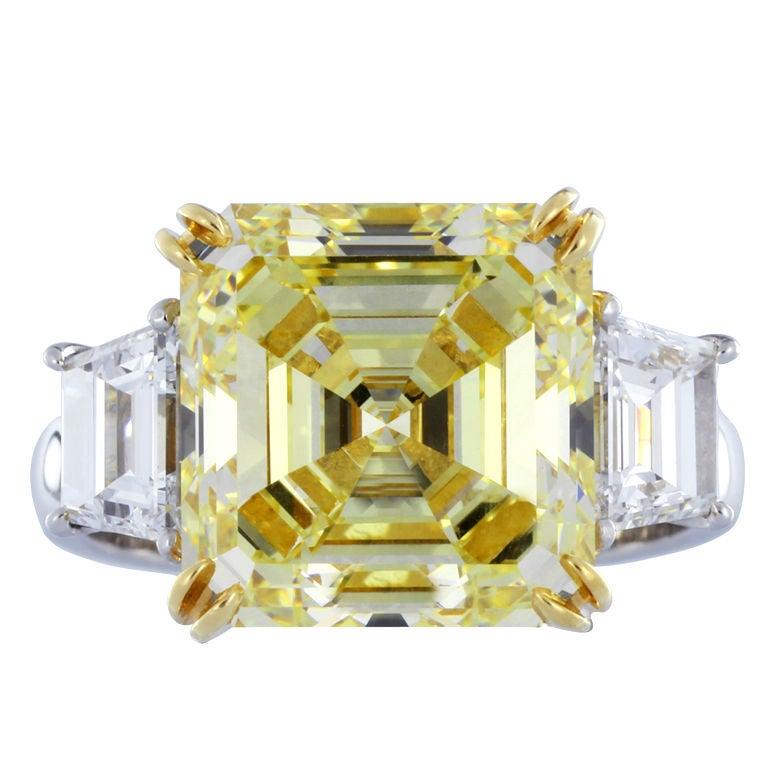 GIA Certified 7.03 Carat Asscher Cut Fancy Yellow VS1 Diamond Platinum Ring