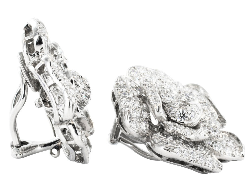Platinum clip earrings consisting of 6.33 carats total weight of round brilliant cut diamonds, signed Oscar Heyman Bros.