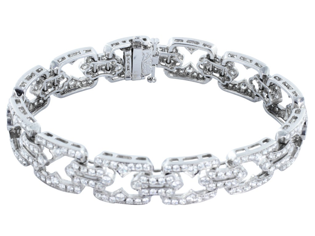 Platinum flexible open work Art Deco style linked bracelet consisting of 7.59 carats total of round brilliant cut diamonds.
