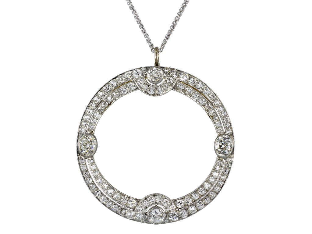 Platinum with 18 karat yellow gold backing Art Deco circle pin with pendant option consisting of Old European and Old Mine cut diamonds having a total weight of approximately 3.50 carats.