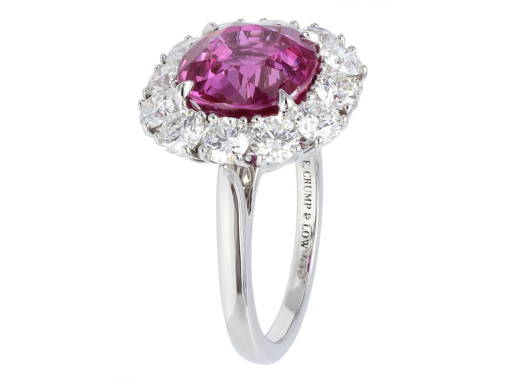 Platinum custom made cluster ring consisting of 1 cushion cut pink Sri Lankan sapphire weighing 5.16 carats, measuring 9.51 x 9.34 x 5.97mm with GIA certificate #2151359472, the center stone is set with 12 round brilliant cut diamonds having a total