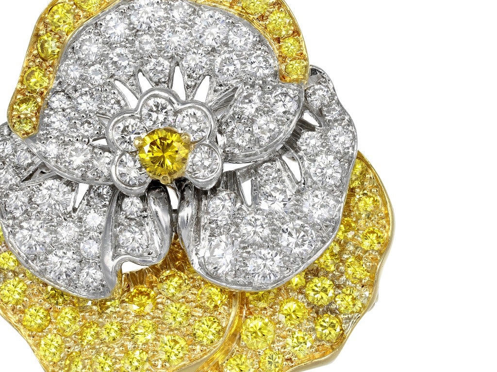 Estate Oscar Heyman Bros platinum and 18 karat yellow gold pansy pin set with colorless diamonds having an estimated total weight of 2.25 carats and natural canary round brilliant cut diamonds having an estimated weight of 2.15 carats, signed