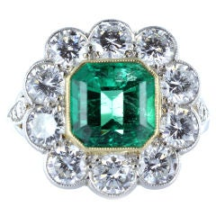 Elegant 1.95 Carat Emerald Diamond Gold Platinum Cluster Ring