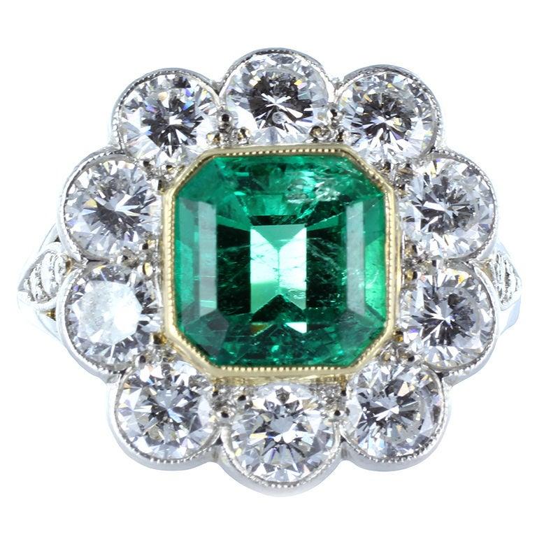 Elegant 1.95 Carat Emerald Diamond Gold Platinum Cluster Ring
