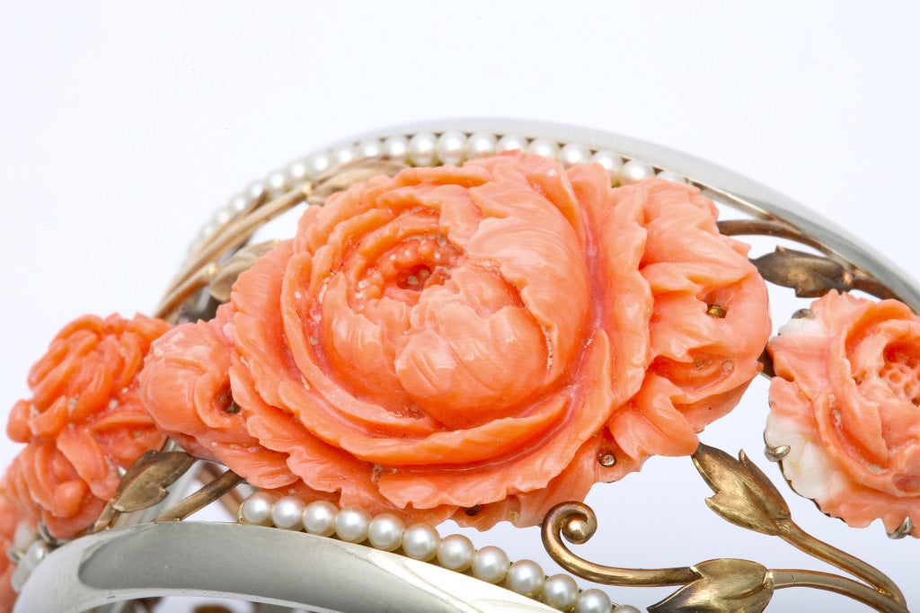 "1930's Carved coral bracelet and ring set, by Detroit jeweler ""Wright Kay & Co."" 14K white and yellow gold, with scrolling flowers and leaves, with 9 delicately carved coral peonies and Japanese chrysanthemums edged in pearls. Bracelet size 7, 1 3/4"