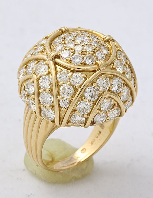 Large scale Harry Winston dome ring in 18KT gold arch motif, set with diamonds. Harry Winston mark.