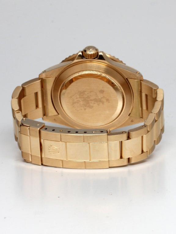 Rolex yellow gold submariner wristwatch ref 16808 circa for Mercedes benz 18k gold ring
