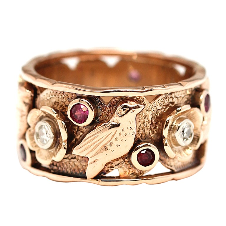 White Godl Ring With Birds And A Ruby