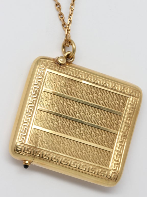 18K yellow gold Art Deco match safe, in pristine condition, shown on antique chain to be worn as a gorgeous and distinctive necklace or locket. Measuring 1.75 x 2 inches. Bowed shape designed to comfortably fit a pocket. Decorated with finely
