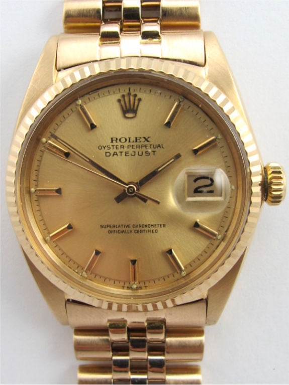 Rolex 18K PG Datejust ref 1601 circa 1962, 36mm diameter case with fluted bezel and mint condition original antique salmon pie pan dial with applied pink gold indexes and pink baton hands. Self winding calibre 1570 movement with sweep seconds and