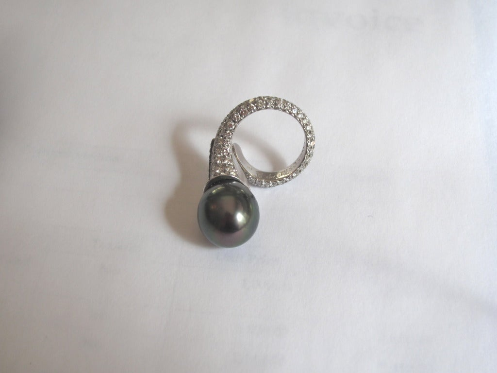 one of a de grisogono and black pearl ring at