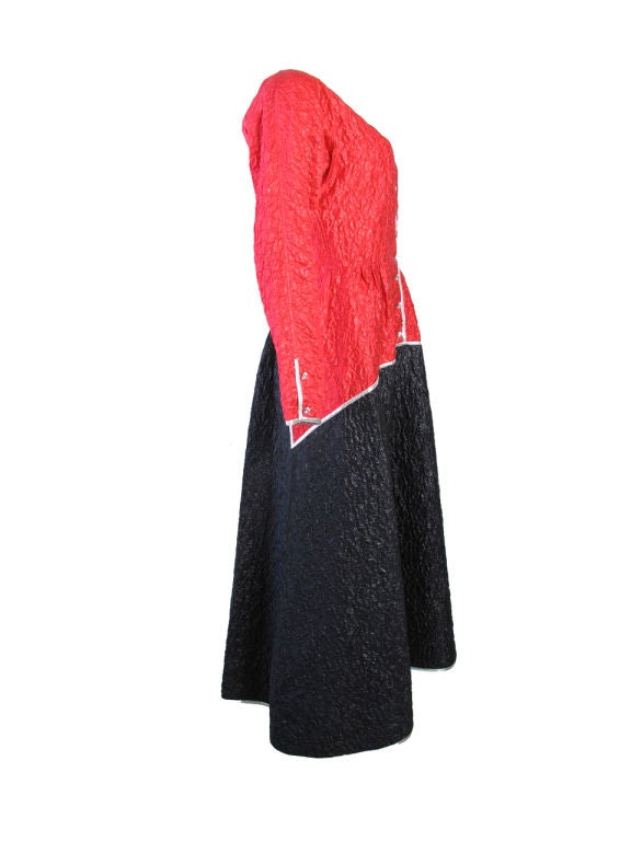 Geoffrey Beene red and black dress with metallic silver trim. Condition:Excellent.