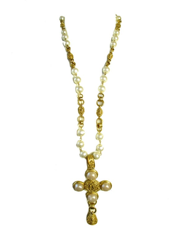 Chanel cross necklace with faux pearls and bell. 