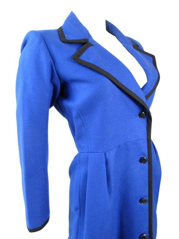 """Yves Saint Laurent blue wool coat with black trim and two side pockets. 39"""" bust, 30"""" waist, 23"""" sleeve, 16"""" shoulder, 39"""" length. Condition: Excellent. Size 36 / 2 - 4  We accept returns for refund, please see our terms.  We offer free ground"""