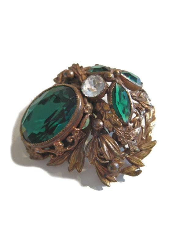 1940s Gorgeous Joseff of Hollywood brooch with green stone. Eugene Joseff was best known for his designs for Hollywood and theatre during the 20s - 40's. This brooch is in very good vintage condition. Signed Joseff of Hollywood.   Company ceased