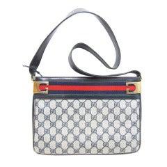 1980s Gucci logo purse with canvas stripe
