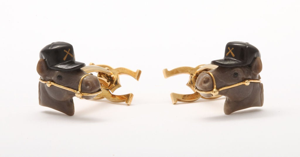 Realistically carved from brown jasper and black onyx, these horse cufflinks are both elegant and discretely whimsical.  The delicately inserted gold bridal is the result of a painstaking collaboration between the stone carver and the goldsmith-