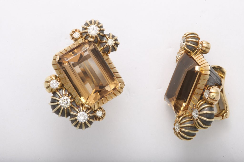 Strikingly unique, these earclips feature very fine emerald cut amber colored tourmalines.  The