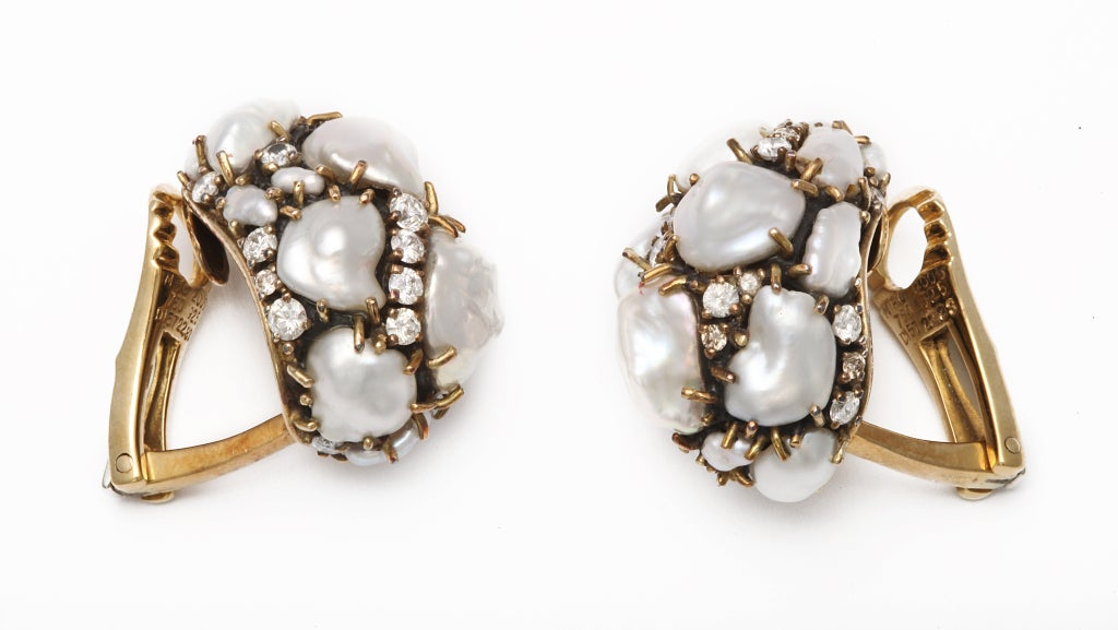 Snowy white keshi pearls and diamonds, mounted in 18kt yellow gold and patinated silver are a trademark Cooperman combination.  The result is a bright and flattering, easily wearable look.  Always unique, no two pairs of Cooperman's earclips are
