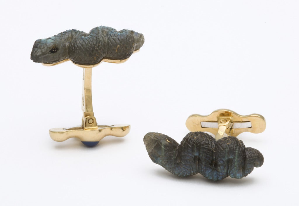 Expertly carved in labradorite, these wonderful snakes show a unique iridescence, found only in this material.  They have just the right amount of edge, while still being quite elegant.  The stones are completely hand carved in Germany and the
