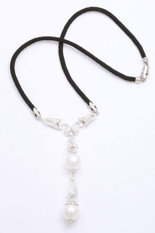 18kt white gold, pearls and diamond on a chic, black cord.  The 16' necklace and the 4' drop are composed of 2 south sea cultured pearls (13.1mm & 14.1mm) and 2.22cts of diamonds.  Made in Italy.  From a family of jewelers dating back to 1927,