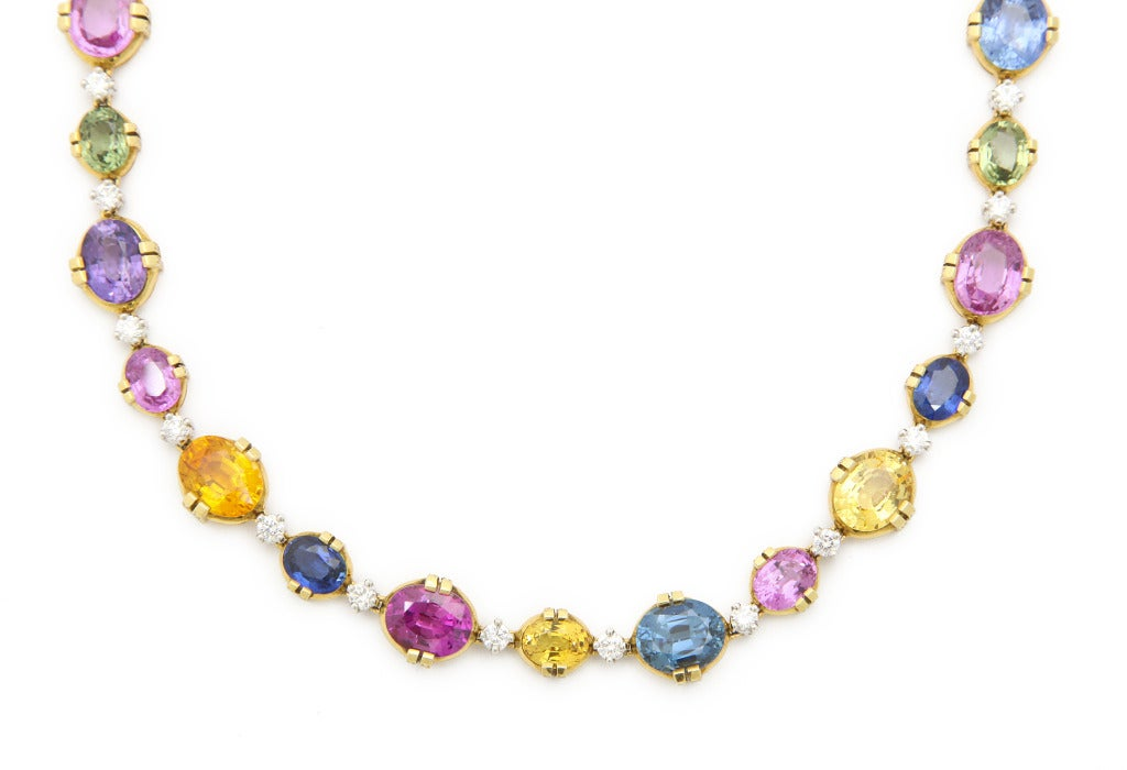 This exquisite necklace features the most beautiful colors of sapphires mined today.  Including vibrant pink, rich blue, bright green, yellow orange and purple, the 16 perfectly cut stones weigh a total of over 75cts.  They are carefully mounted in