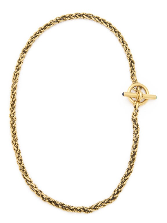 This beautiful textured 18kt gold chain features a toggle clasp set on one side with a cabochon emerald and on the other side with a cabochon sapphire.  At 21.5 inches it can also be wrapped multiple times on the wrist to be work as a