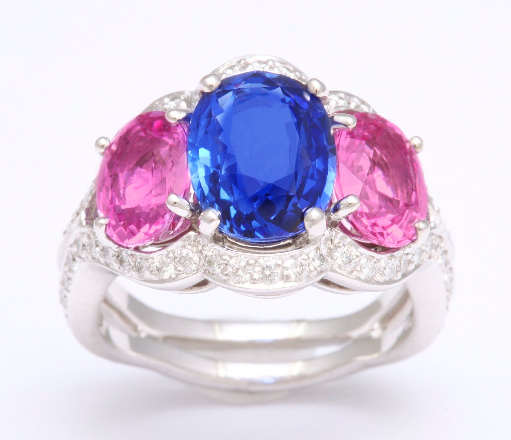 A bright blue oval sapphire (3.51cts) and 2 vibrant pink oval sapphires (total weight 3.37cts) are expertly set in platinum and diamond (total weight 0.98cts).  An expertly crafted classic from one of the best workshops in New York.  Presently size