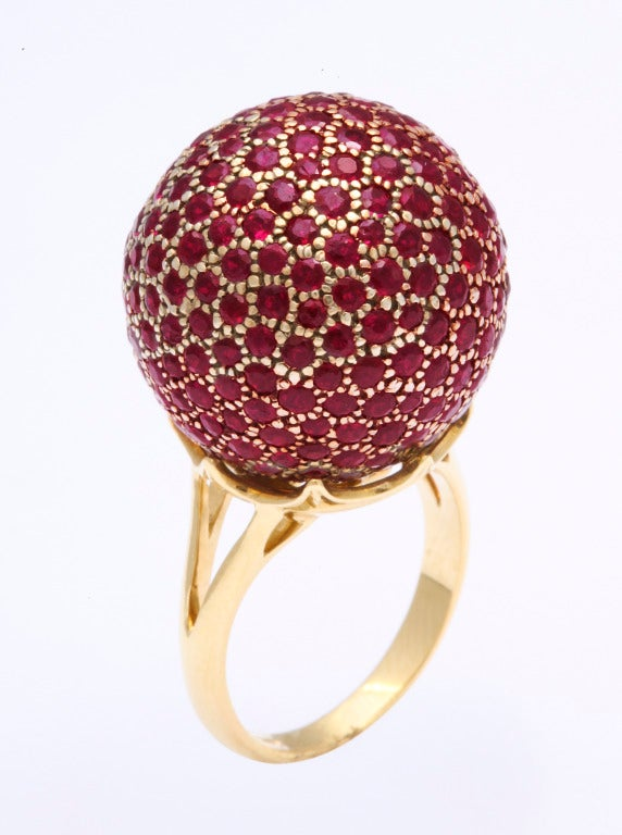The 20mm ball is expertly set with 246 rubies weighing a total of 8.10 carats.  Very finely crafted, this show stopper will not go unnoticed.  Made in New York by the exceptional workshop Tanagro.